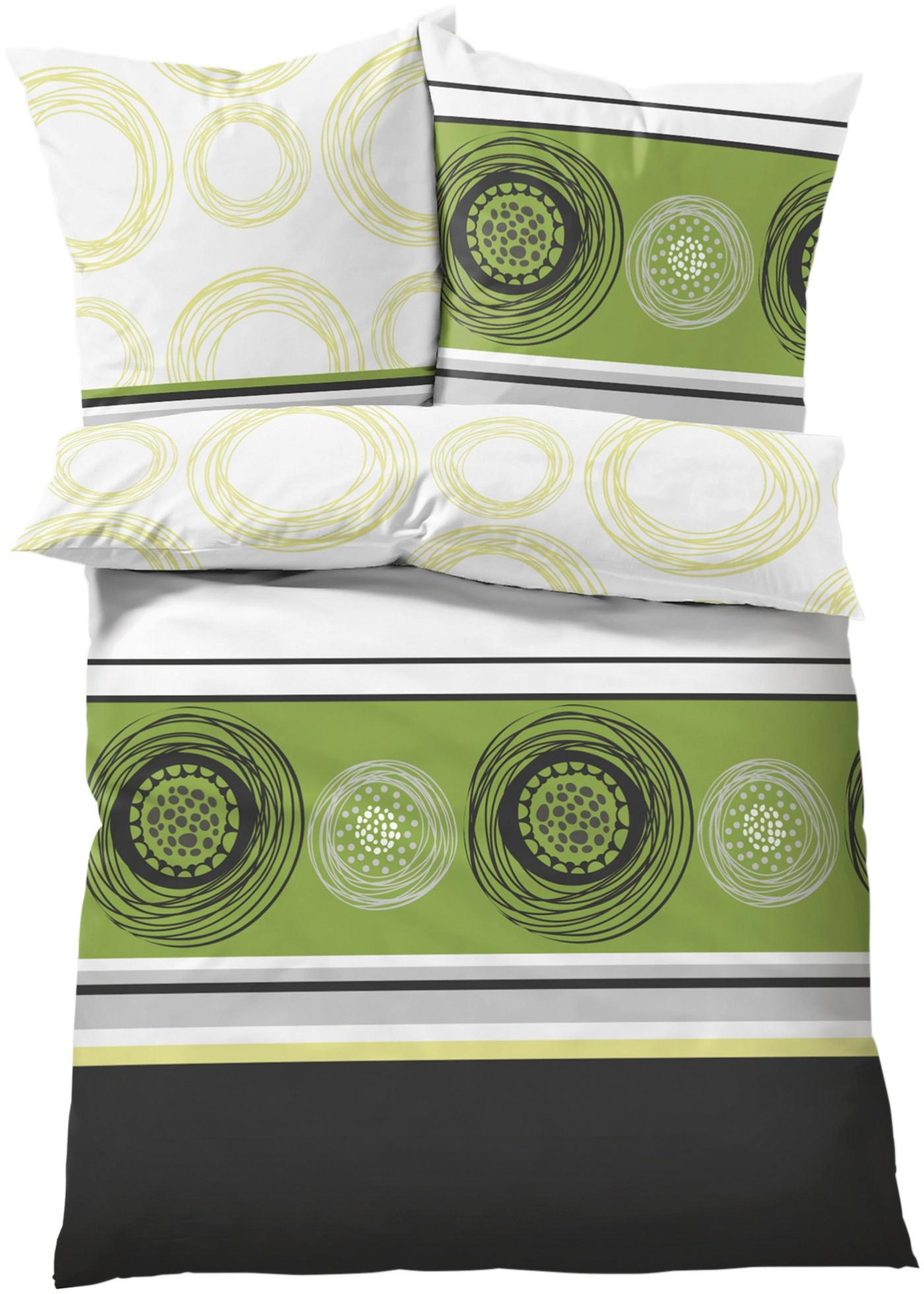 Magnifique parure de lit imprimée à motif moderne combinant rayures et cercles géométriques. Effet chic. Différentes qualités de coton au choix. Disponible en parure 2 ou 4 pces. et en taille supérieure XXL.