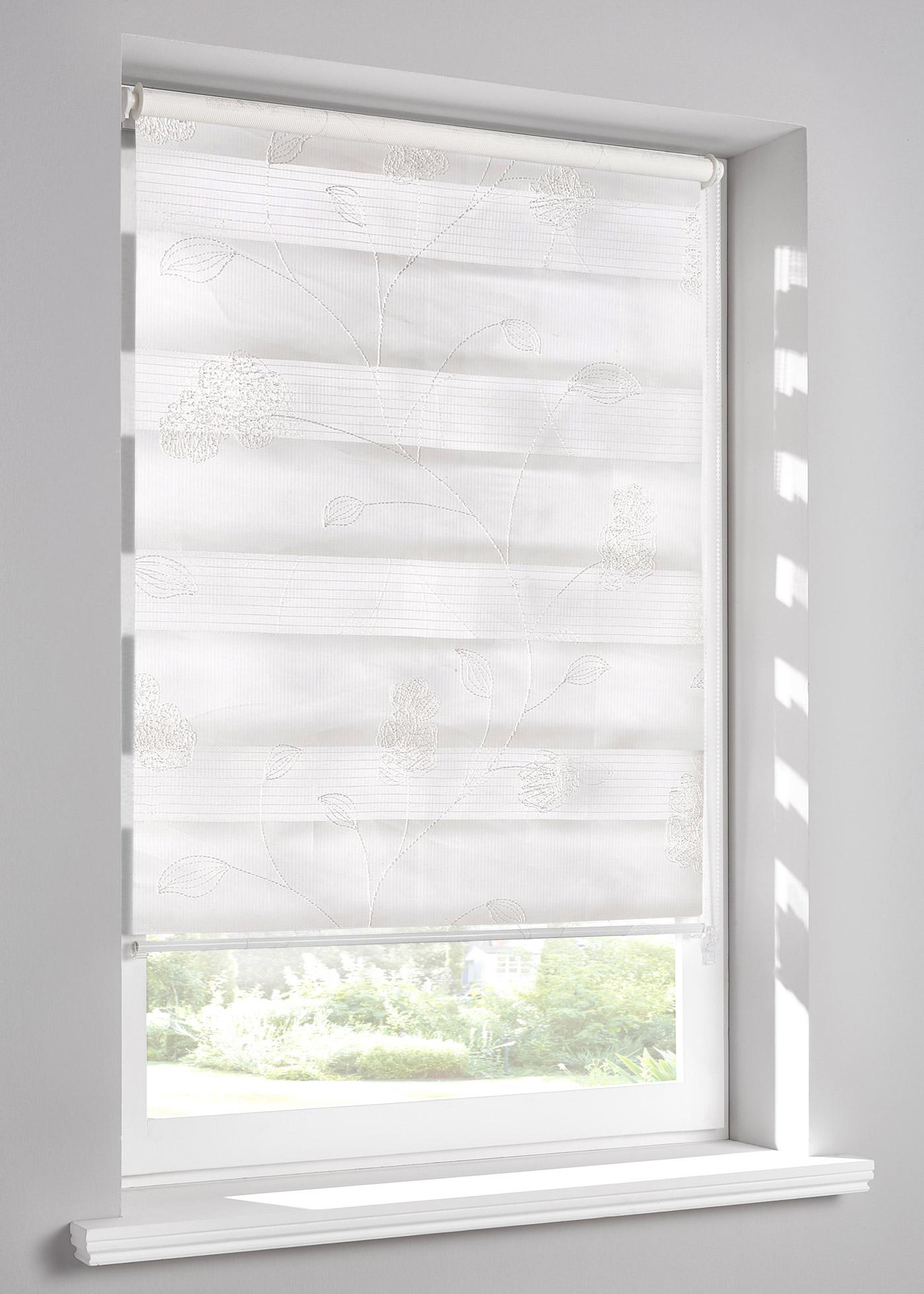 """Store double brodé, protège de la lumière sans occulter. Pose facile avec supports de fixation à clipser directement sur le cadre de fenêtre (épaisseur de châssis jusqu""""à 1,6cm), cordon sur la droite, les deux bandes de tissu se superposent ou juxtap"""