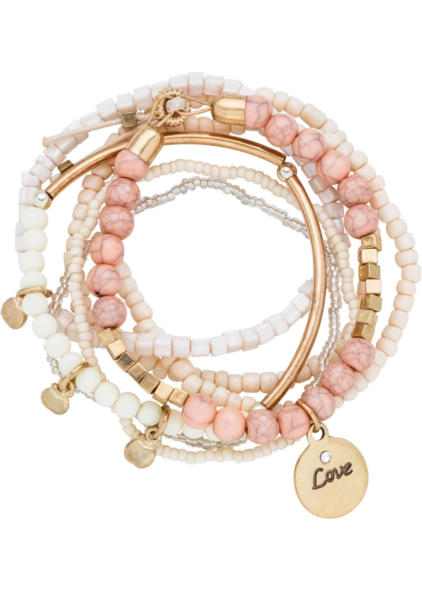 Set de bracelets de coloris parfaitement assortis. Forme élastique.