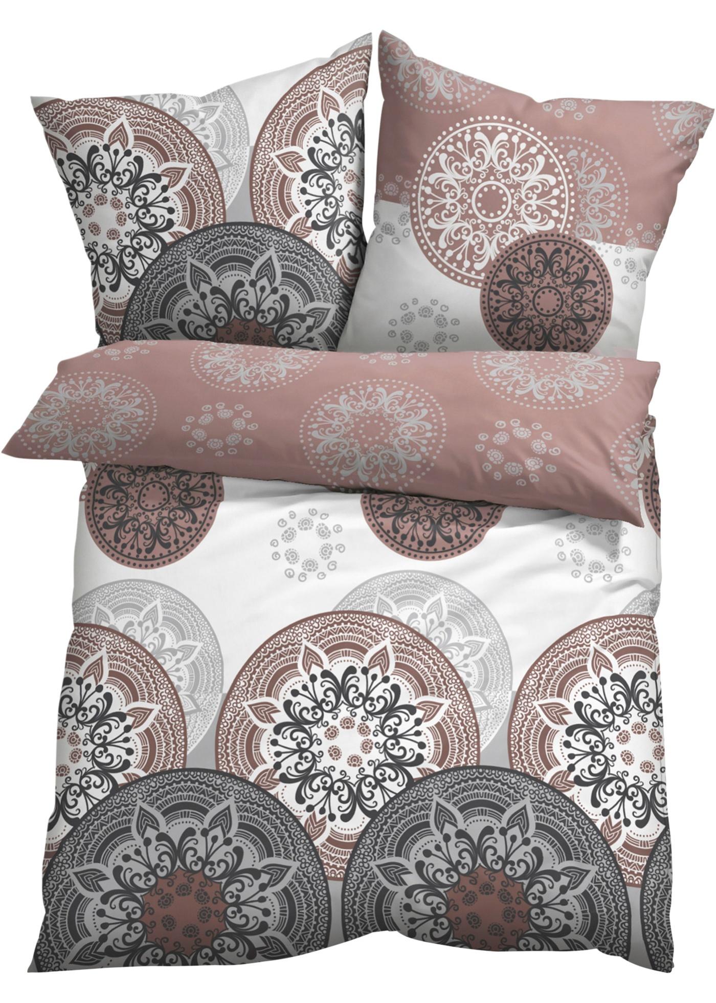 Parure de lit élégante avec des jolis motifs graphiques dans des tonalités harmonieuses. Différentes matières au choix.