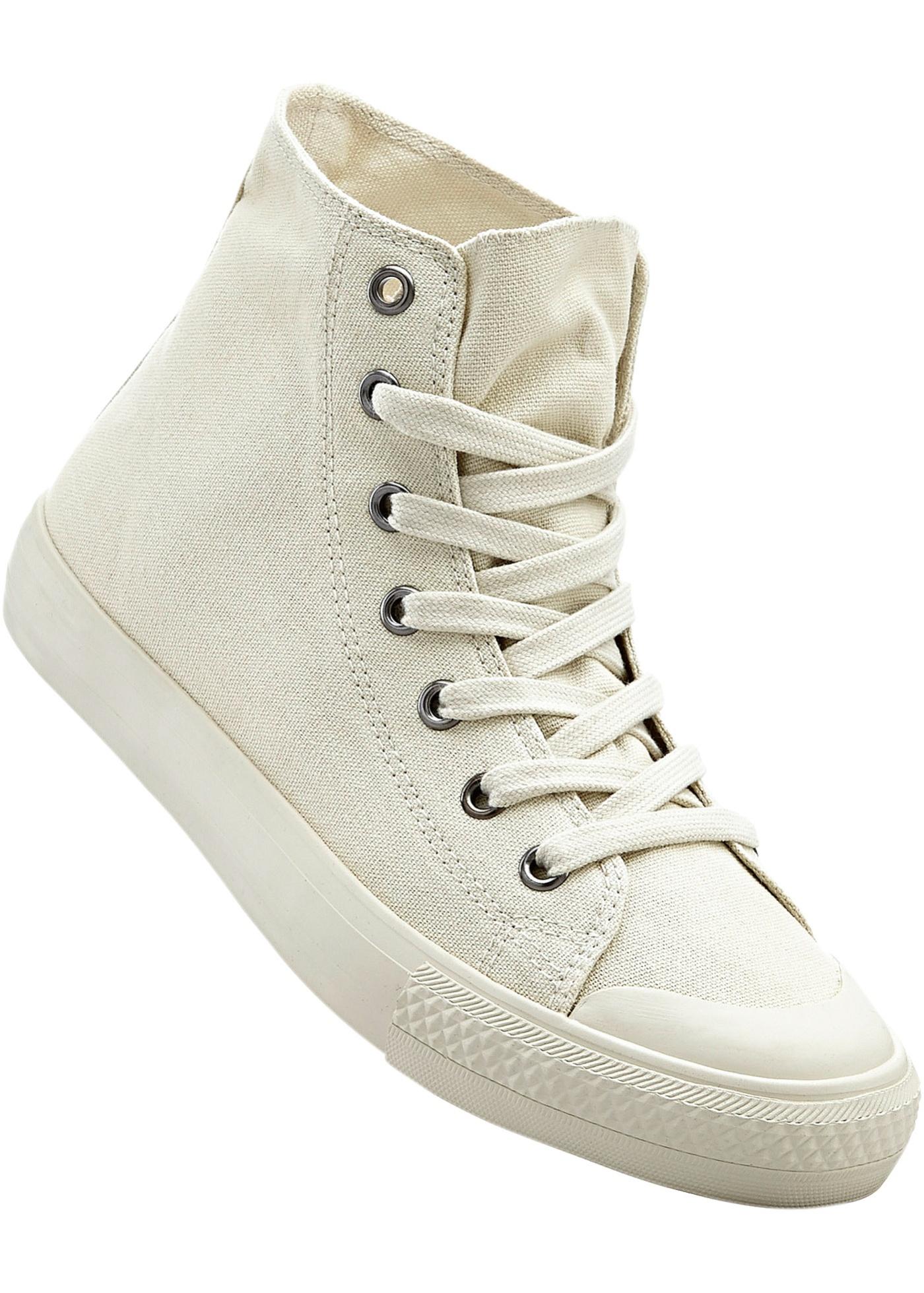 Sneakers à lacets, semelle extérieure légèrement profilée.