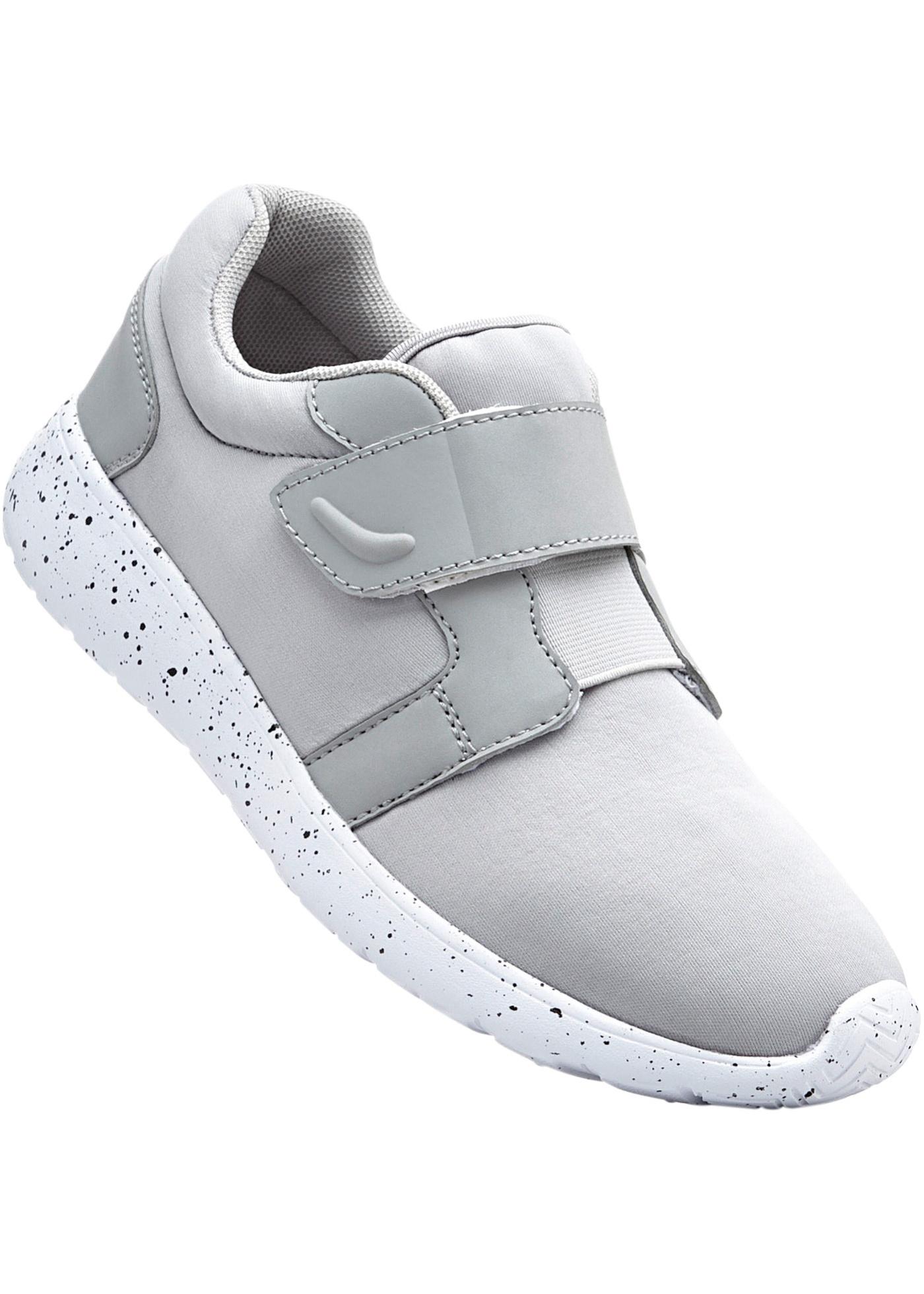 """Sneakers avec fermeture auto-agrippante, élastique d""""aisance pour ajuster l""""ampleur, semelle extérieure légère."""